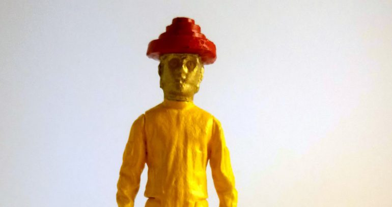 "a photograph of the action figure mashup ""C3Devo"""