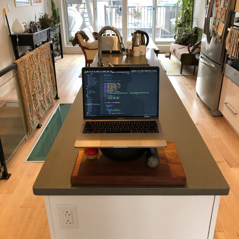 a computer set up on a kitchen counter